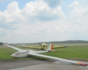 Scheibe SF-34 sailplane parked on a grass runway